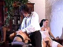 Two mature vixens in orgy